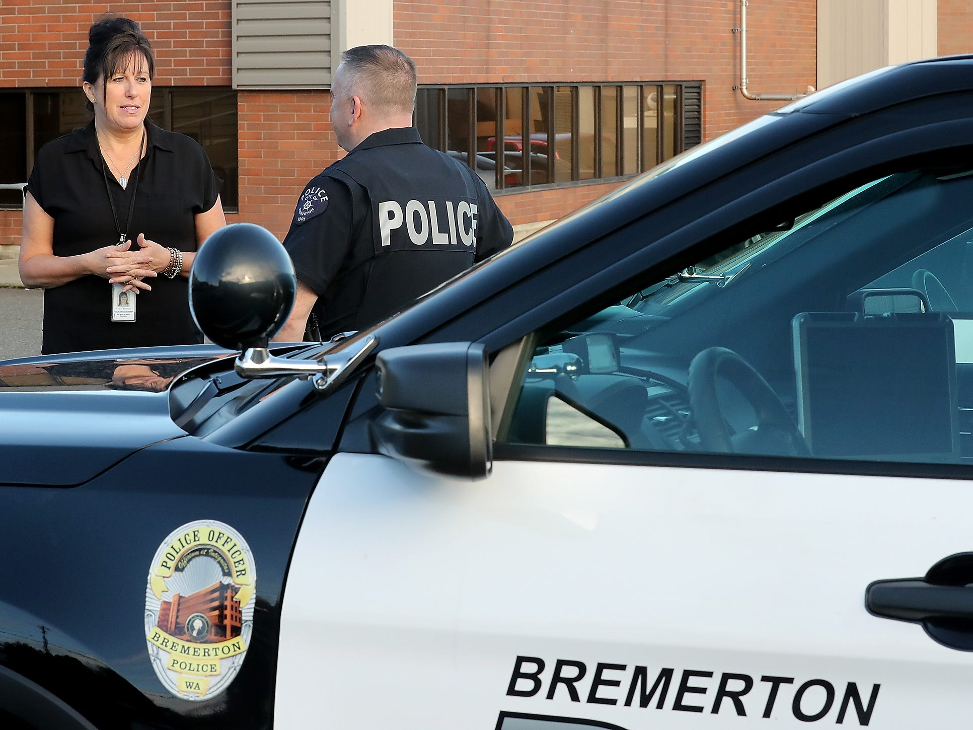Behavioral Health Navigator Laurel MacIntyre-Howard talks with Capt. Randy Plumb at the Bremerton Police Department on Friday, November 16, 2018.