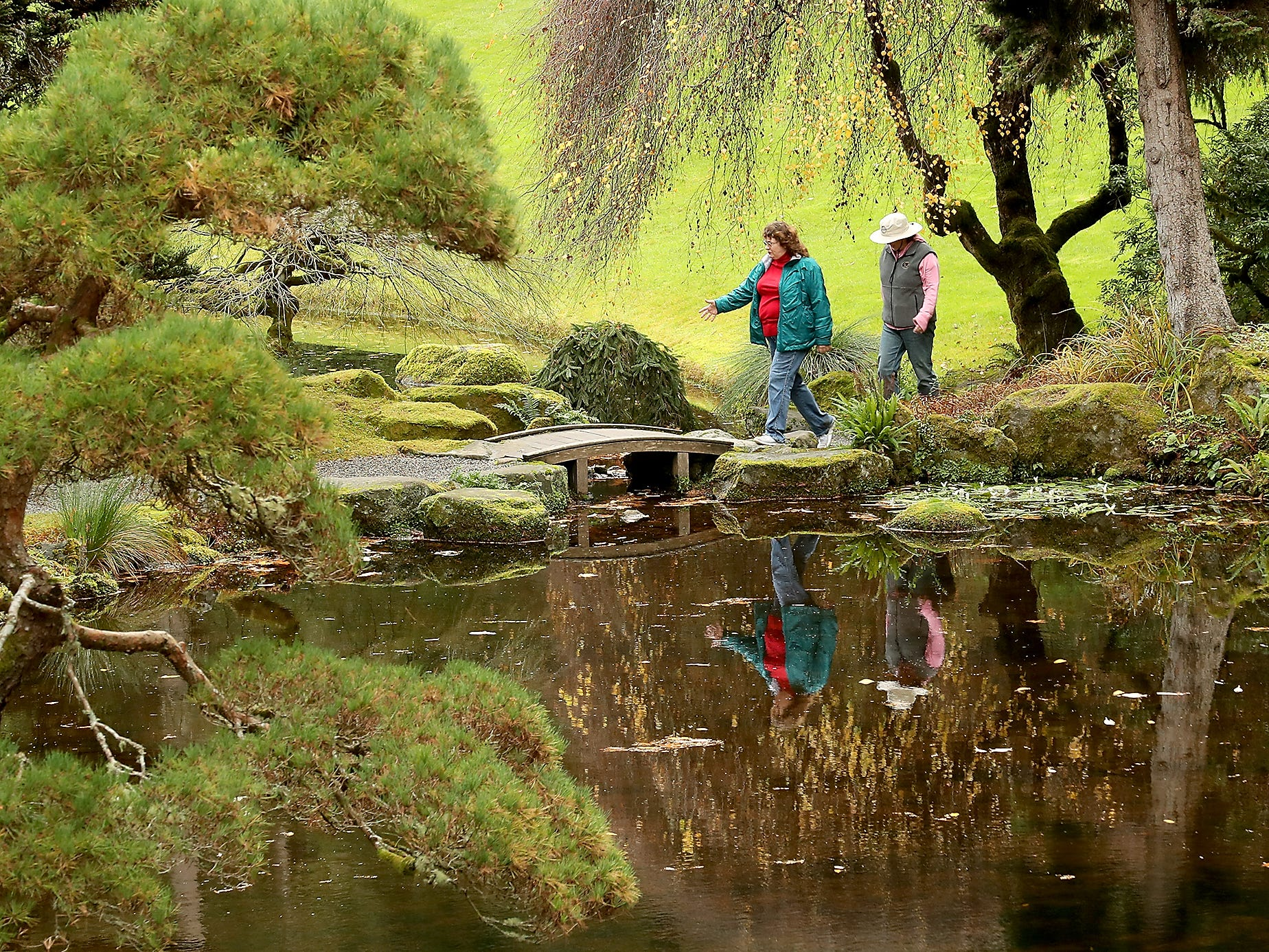 Flo Garetson and Sarah Slotten, both of Suquamish, walk through the Japanese Garden in Bloedel Reserve on Friday, November 16, 2018. The two are regular visitors to Bloedel and walk the trails every Friday rain or shine.
