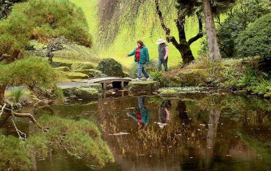 Flo Garetson and Sarah Slotten, both of Suquamish, walk in the Japanese Garden at Bainbridge Island's Bloedel Reserve.