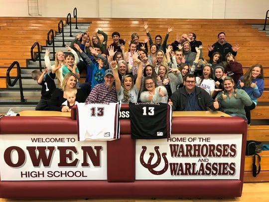 Family and friends celebrate with Owen High School senior Chesney Gardner after she signed a letter of intent to play basketball at USC Aiken.
