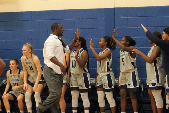 Montreat College women's basketball head coach Tim Lewis congratulates his team on a triple overtime win over Appalachian Athletic Conference opponent Point University.