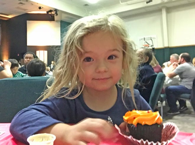 Isabella gets ready to eat a cupcake at her VPKs Feast of Thanks last week.