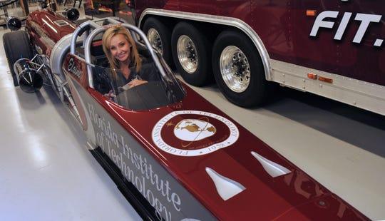 Elaine Larsen, president of Larsen Motorsports in Palm Bay, drives the Florida Institute of Technology jet dragster.
