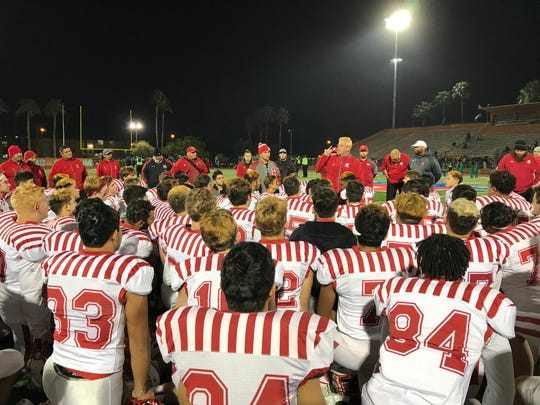 Ray head coach Craig Charlton addresses the Texans after their 42-7 win over Brownsville Pace in the bi-district playoffs at Brownsville's Sam's Memorial Stadium on Thursday, Nov. 16, 2018.