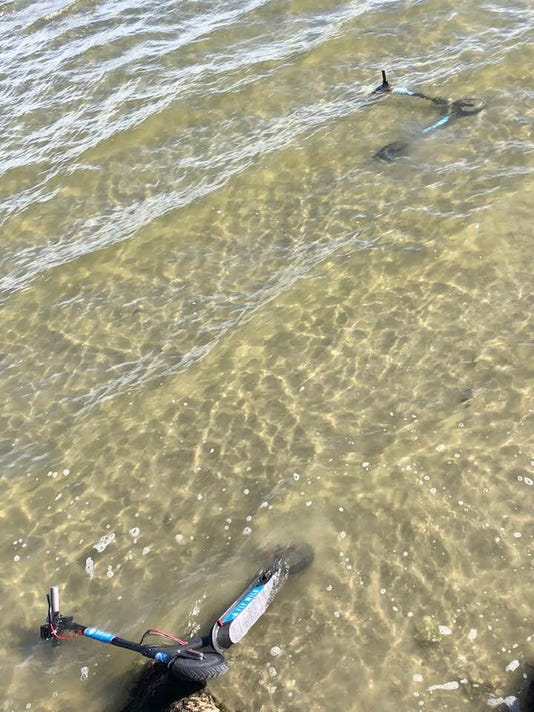 Scooters Found In Water