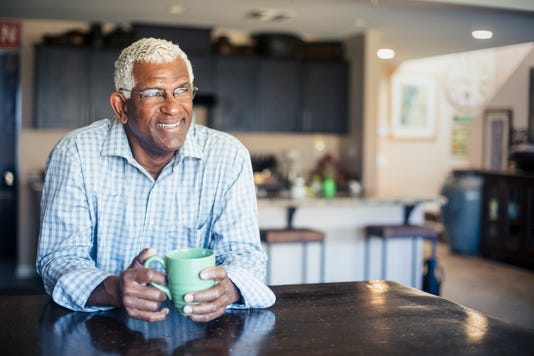 Senior Black Man Enjoying A Cup Of Coffee At Home