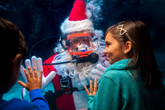 Kids can visit with Scuba Santa at Newport Aquarium through Dec. 31.