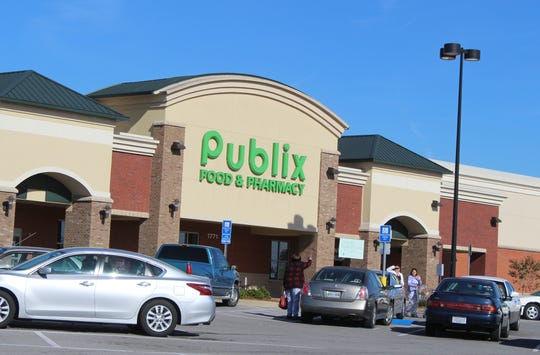 Shoppers greet each other outside the Publix grocery store on Madison Street in south Clarksville.