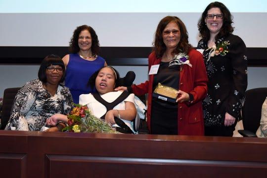 (From left)Nina Stringer's caregiver Iocent; Ellen Ball Nalven, executive director, PLAN/NJ; Nina Stringer; Coach C. Vivian Stringer; and Samantha Herrick, president, PLAN/NJ Board of Directors.