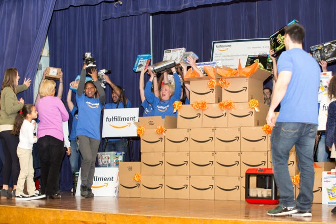 Amazon donates STEM supplies at Columbus School in Carteret on Wednesday.