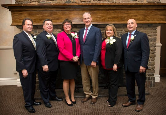 Shown with Thomas Kemly, center, president and CEO of Columbia Bank, are the bank's 2018 Community Service Award winners. (From left) Mark Proudman, Bob Cleveland, Margie Hochkeppel, Shannon Brand and Paul Vicente.