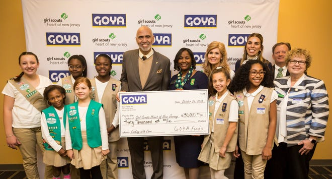 Representatives from Goya present GSHNJ with a donation for their patch program