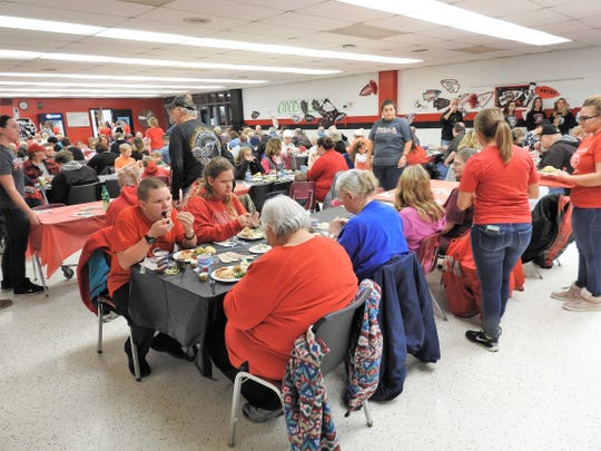 About 600 meals are usually served for the annual community Thanksgiving dinner held at Coshocton High School with students helping to seat, serve and clear tables.
