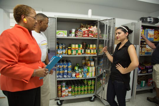 "Maria Rose Belding poses at a food pantry after winning a ""Women of Worth"" award from L'Oreal."