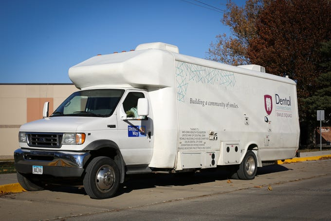 A Dental Connections mobile unit is parked outside Karen Acres Elementary School on Nov. 15, 2018 in Urbandale, Iowa. Dental Connections is a mobile unit that provides basic dental check-ups for students. Jenny Villegas, the school's nurse, spearheaded the program for students to receive dental services who may not otherwise receive them.
