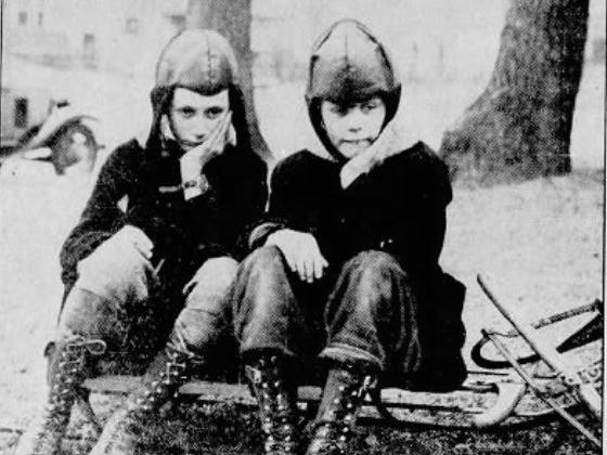 "From Jan. 8, 1931 Des Moines Tribune: ""What's the use of getting a sled for Christmas if there's never any snow?"" asked 11-year-old George Thomas, left, and 8-year-old Ralph Baker, both of Des Moines."