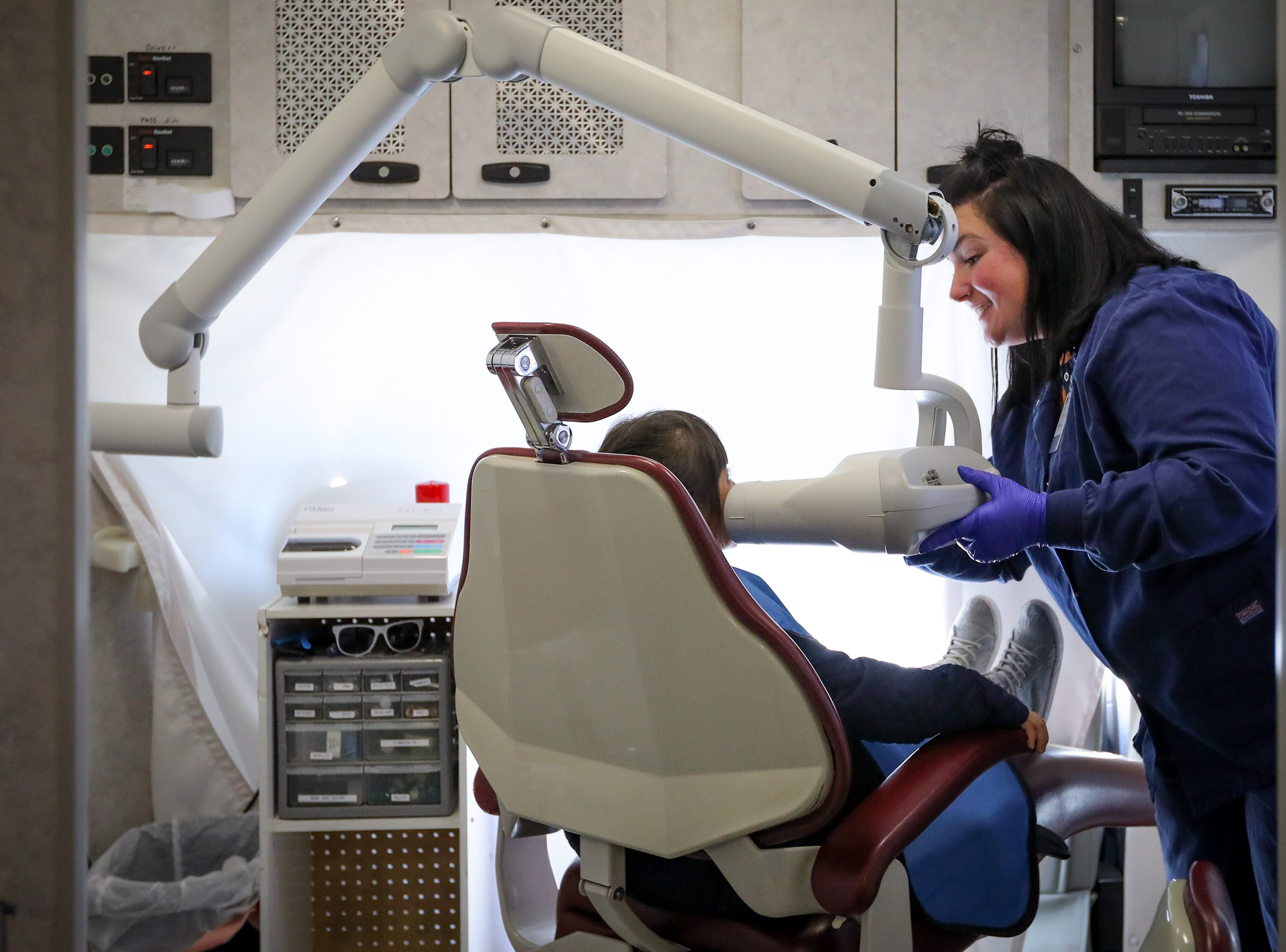 Hygienist Carissa Thompson, 37, of Des Moines, sets up the x-ray machine in the Dental Connections mobile unit at Karen Acres Elementary School on Nov. 15, 2018 in Urbandale, Iowa. Dental Connections is a mobile unit that provides basic dental check-ups for students.