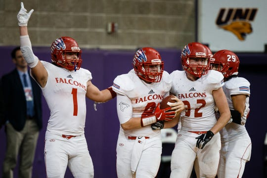 West Sioux, Hawarden's Hunter Dekkers (8) celebrates his touchdown to making the score 51-38 during their class 1A state championship football game on Friday, Nov. 16, 2018, in Cedar Falls. West Sioux, Hawarden would go on to beat Dike-New Hartford 52-38.