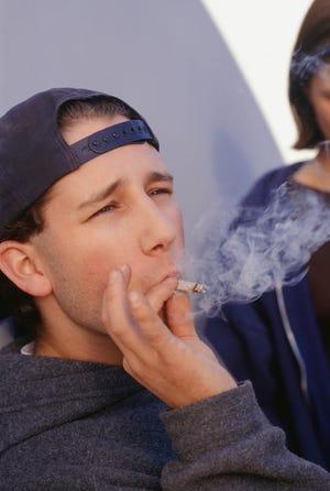 Teen smoking marijuana