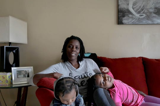 Shalandra Jones- Scott in her home with her grand children Samaar Jones, 1, left and Sameer Jones, 6 in Detroit on Friday, October 19, 2018. Jones-Scott and her husband bought the home from a relative in 2015 but the relative had not paid the back taxes. The house was foreclosed and slated for auction this year but through a program started last year between the city of Detroit and the United Community Housing Coalition Scott-Jones will be able to get the deed of the home back for $1000.