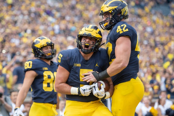 During his career Jared Wangler (5) has seen Michigan go from no bowl game to a shot at the College Football Playoff.
