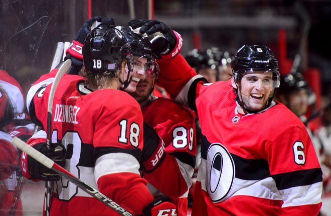 Ottawa Senators right wing Drake Batherson (79), middle left, celebrates his first NHL goal during the second period.
