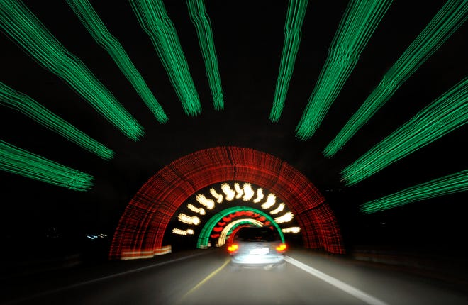 (CAPTION INFORMATION)Cars drive through the Wayne County light fest.             Photos are of the opening night of the Wayne County Light Fest in Westland, November 18, 2010.    (David Guralnick / The Detroit News)