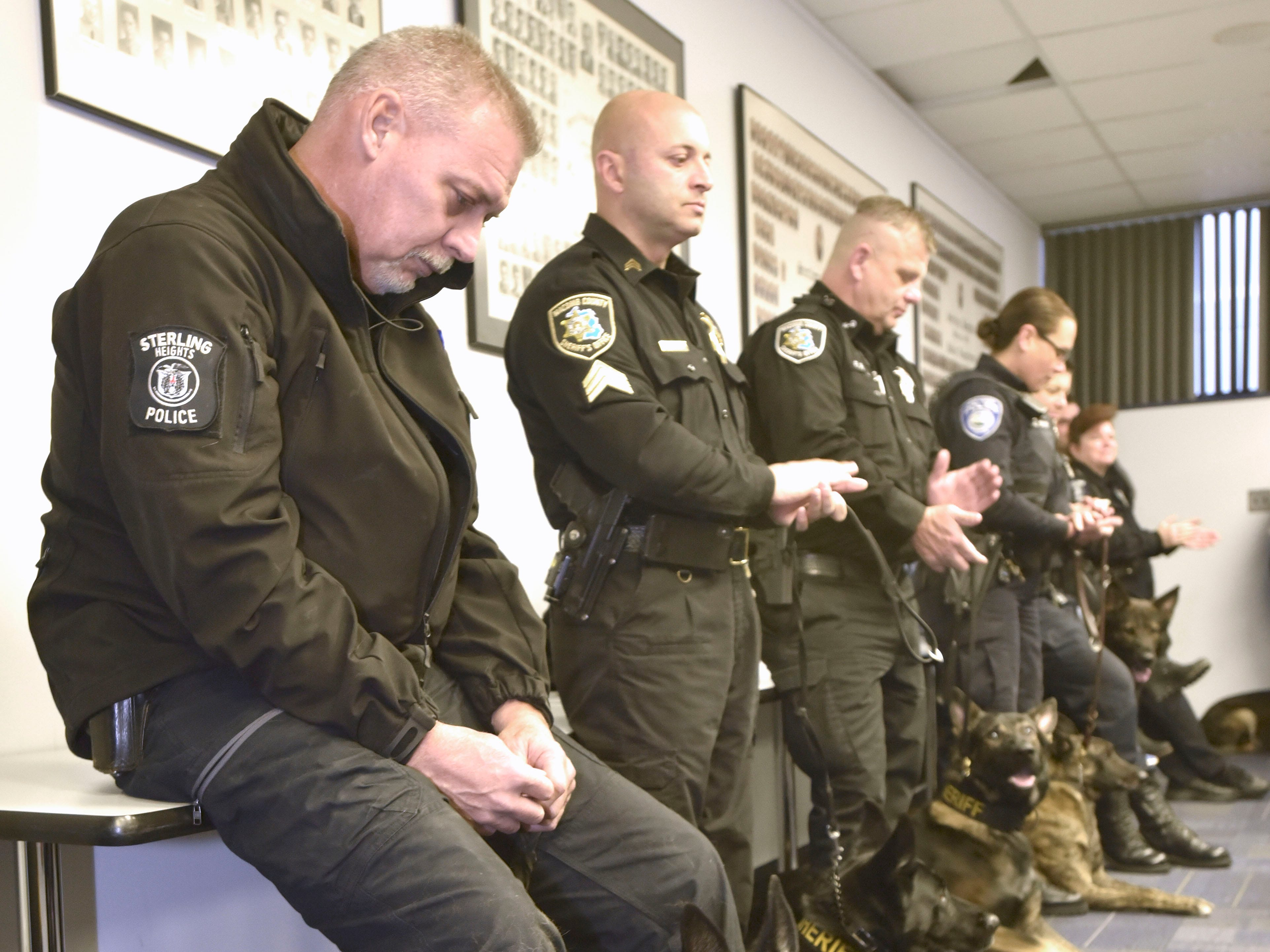 Sterling Heights Police K-9 officer Rich Heins tries to keep his emotions in check during the retirement ceremony for his police dog, Chase. Other department K-9 officers attended to show their respects at Sterling Heights Police Department, Friday, Nov. 16, 2018.