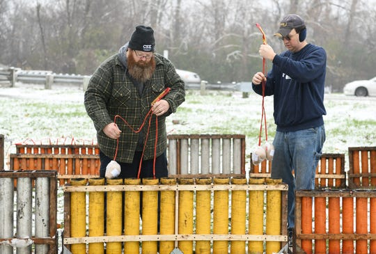Pyrotechnicians Mike Riha, left, and and Duffy Naughton of American Fireworks set up fireworks for the opening ceremony.