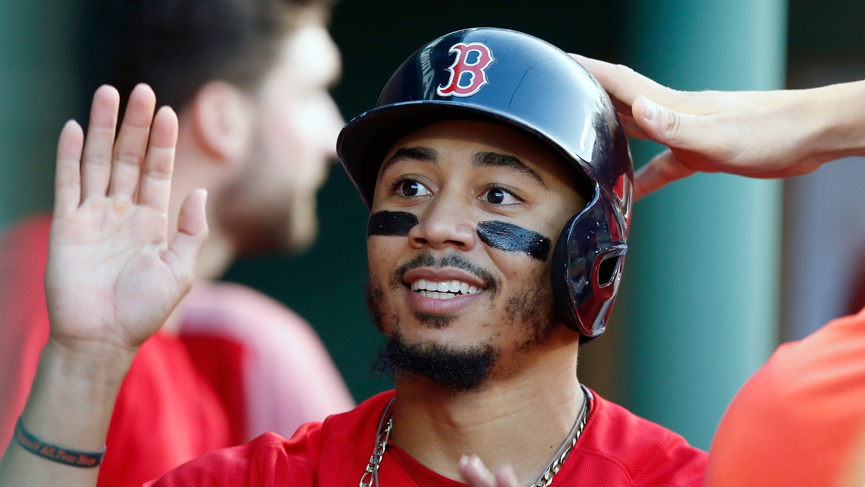 Boston's Mookie Betts and Milwaukee's Christian Yelich were runaway winners of the Most Valuable Player awards after the 26-year-old outfielders each led their teams to first-place finishes with dominant seasons that included batting titles.