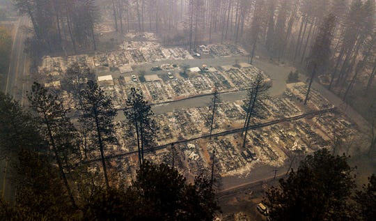 Residences leveled by the wildfire line a neighborhood in Paradise, Calif., on Thursday, Nov. 15, 2018.
