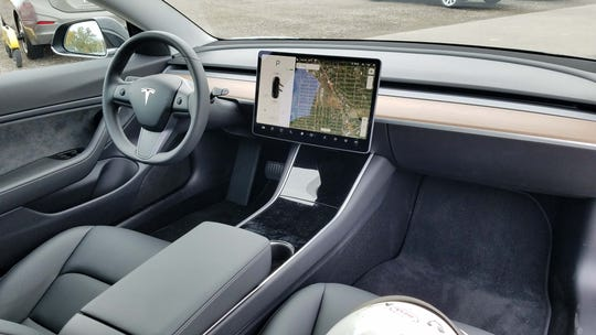 The Tesla Model 3 is almost entirely controlled via its 15-inch touch screen, making it an iPhone on wheels.