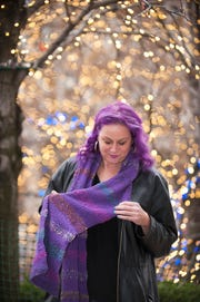 Diana McNary models a purple knitted scarf.