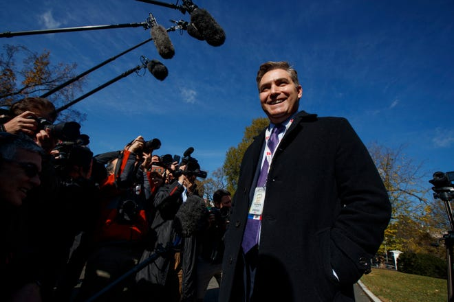 CNN journalist Jim Acosta talks with reporters as he arrives at the White House after having his press pass restored, Friday, Nov. 16, 2018, in Washington.