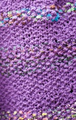 A purple knitted scarf.