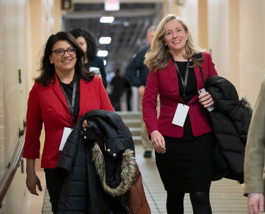 Rep.-elect Rashida Tlaib, D-Mich., left, and Rep.-elect Abigail Spanberger, D-Va., head to a Democratic Caucus meeting in the basement of the Capitol as new members of the House and veteran representatives gathered behind closed doors to discuss their agenda when they become the majority in the 116th Congress, in Washington, Thursday, Nov. 15, 2018.