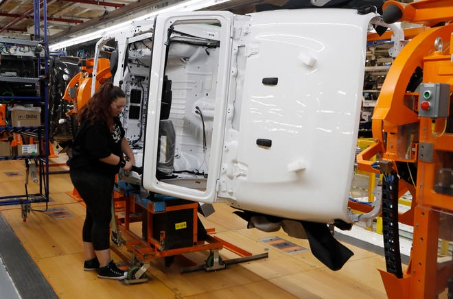 A 2019 Jeep Wrangler is turned sideways to allow easier access at the Toledo North Assembly Plant, Friday, Nov. 16, 2018, in Toledo, Oh.