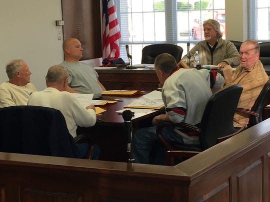 Boonville Mayor Charlie Wyatt presides over Friday's called meeting of the City Council, which unanimously approved a compromise effectively ending the city's dispute with Alcoa about coal mining activities at Liberty Mine.