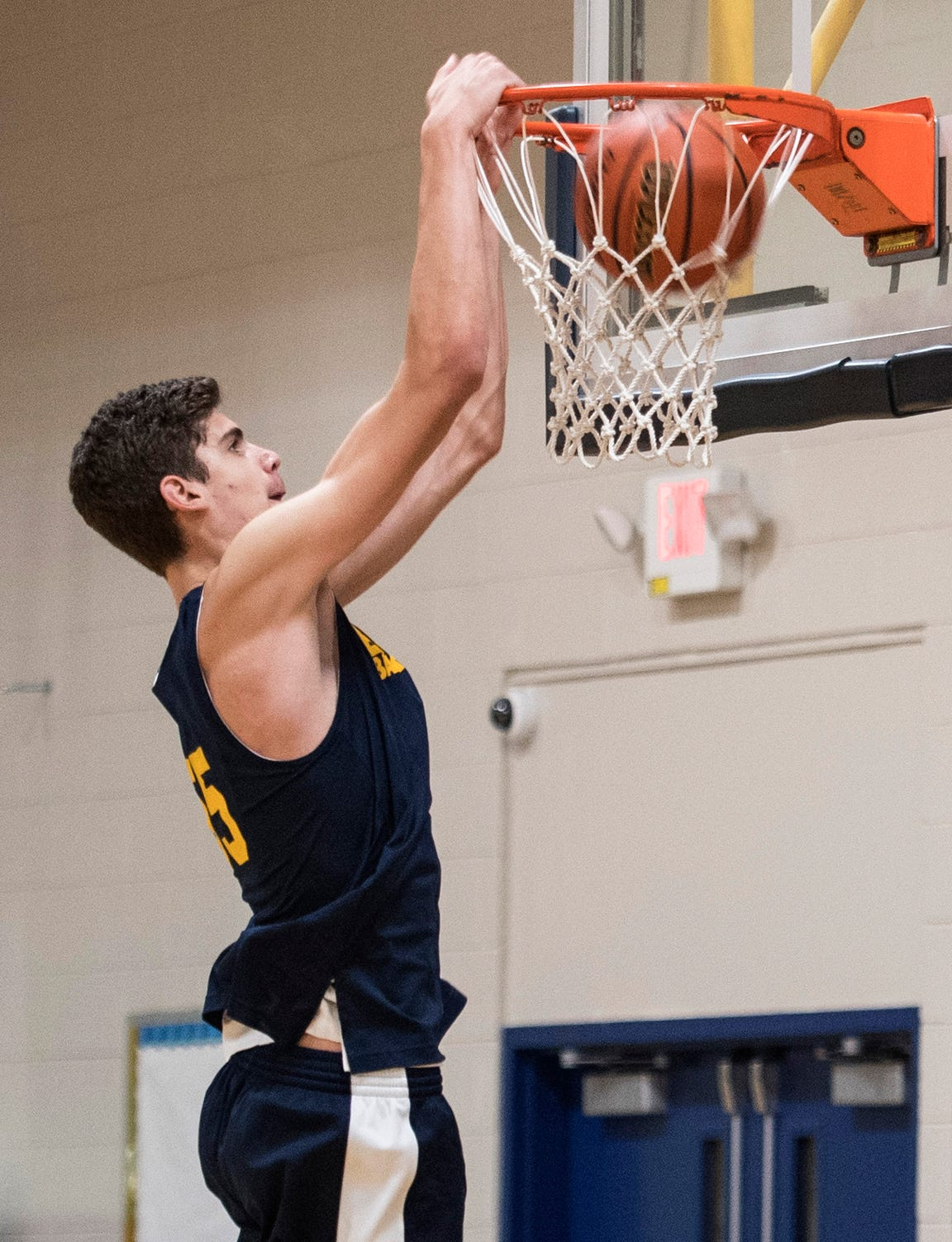 The 7 feet 1 inch junior Noah Hupmann slams the ball into the basket during a practice at Evansville Day School Tuesday, Nov. 13, 2018.