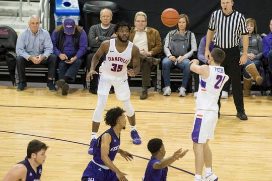 UE's Shea Feehan (21) passes the ball to UE's John Hall (35) during the University of Evansville vs Kentucky Wesleyan exhibition game at the Ford Center Thursday Nov. 15, 2018.