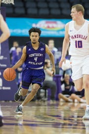 Kentucky Wesleyan's Erik Bell (4) dribbles the ball down court during the University of Evansville vs Kentucky Wesleyan exhibition game at the Ford Center Thursday Nov. 15, 2018.