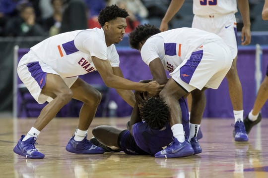 UE's Marty Hill (1) and Shamar Givance (5) fight for the ball during the University of Evansville vs Kentucky Wesleyan exhibition game at the Ford Center Thursday Nov. 15, 2018.