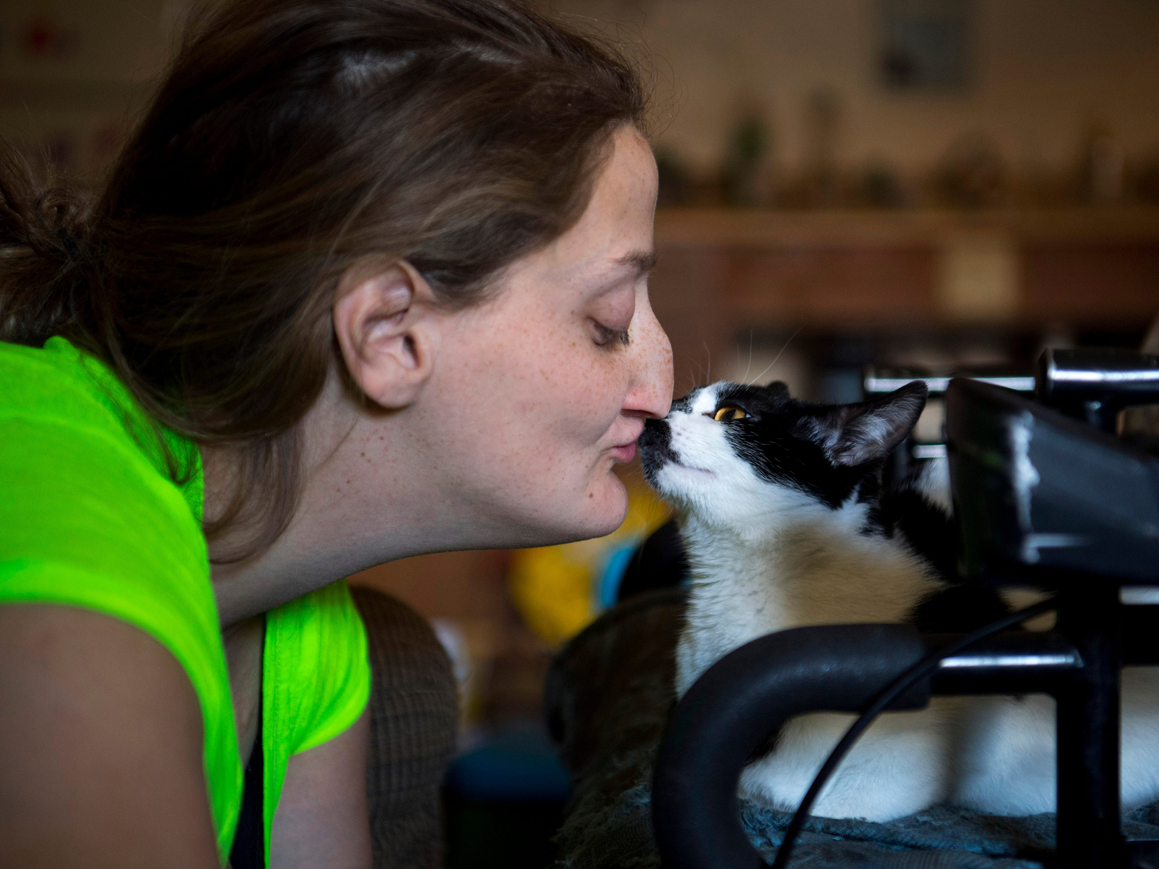 Oreo was a tiny kitten when Amanda and Leland adopted her. Now the full-grown cat keeps Amanda company when Leland is at school.