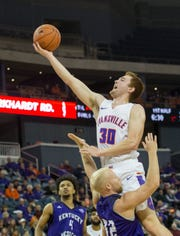 UE's Noah Frederking (30) reaches for the basket during the University of Evansville vs Kentucky Wesleyan exhibition game at the Ford Center Thursday Nov. 15, 2018.