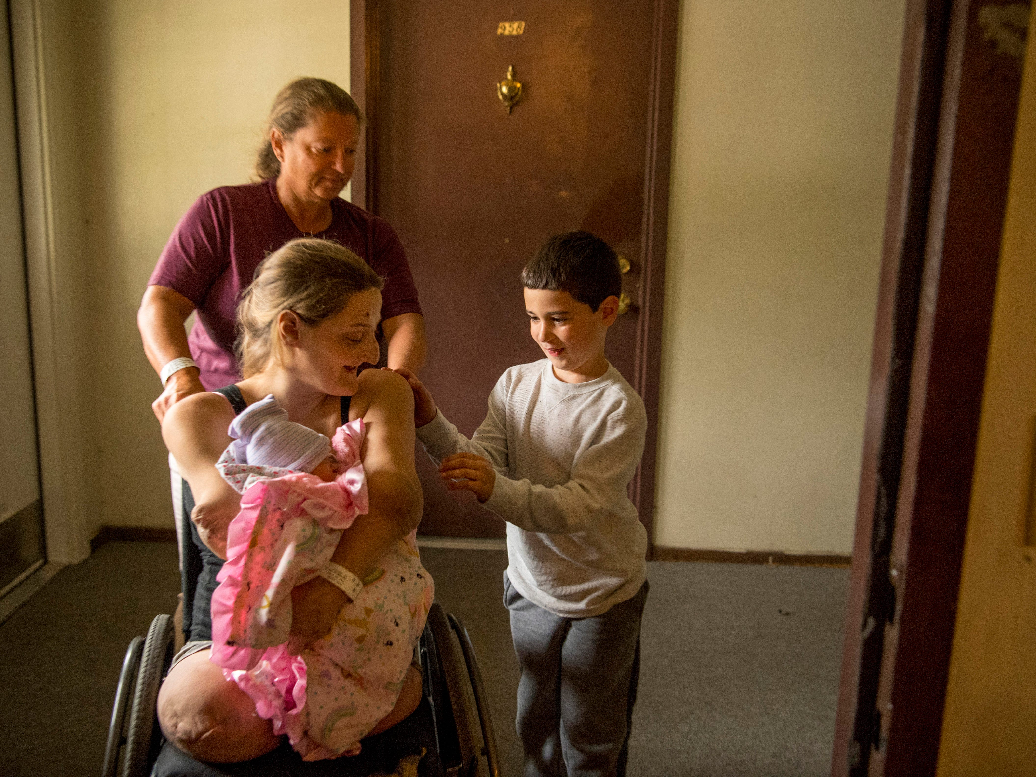 Leland, 6, sees his new baby sister for the first time as his mom, Amanda Smith, arrives home from the hospital Monday afternoon, Sept. 24, 2018. Amanda's aunt, Rosanna Funkhouser, provided the pushing power into their Mount Vernon, Ind., apartment.