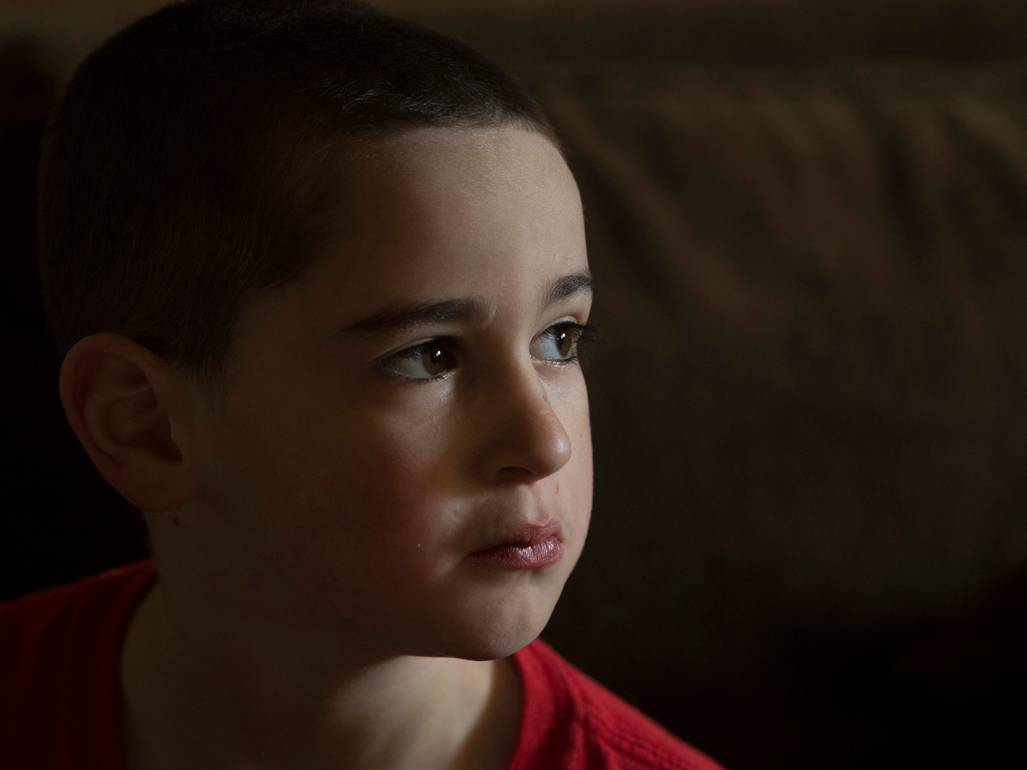 Leland sports a fresh haircut as he watches television after school in January of 2018. The boy has had to grow up a little faster than most to help his mom out.