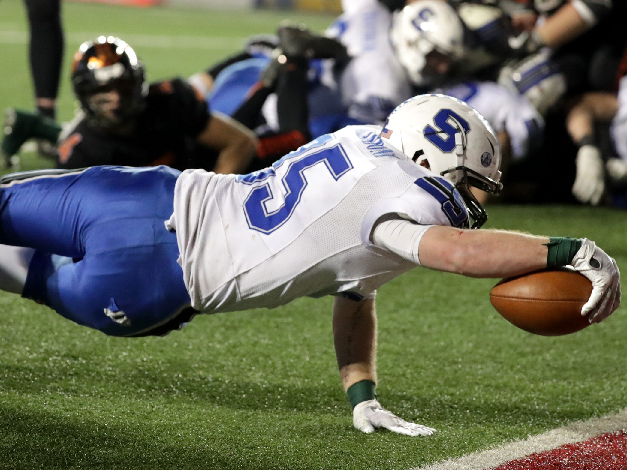 St. Mary's Springs Academy's #35 Marcus Orlandoni scores a go ahead touchdown in the fourth quarter against Stratford High School during the WIAA Division  5 state championship football game on Thursday, November 15, 2018, at Camp Randall in Madison, Wis.
