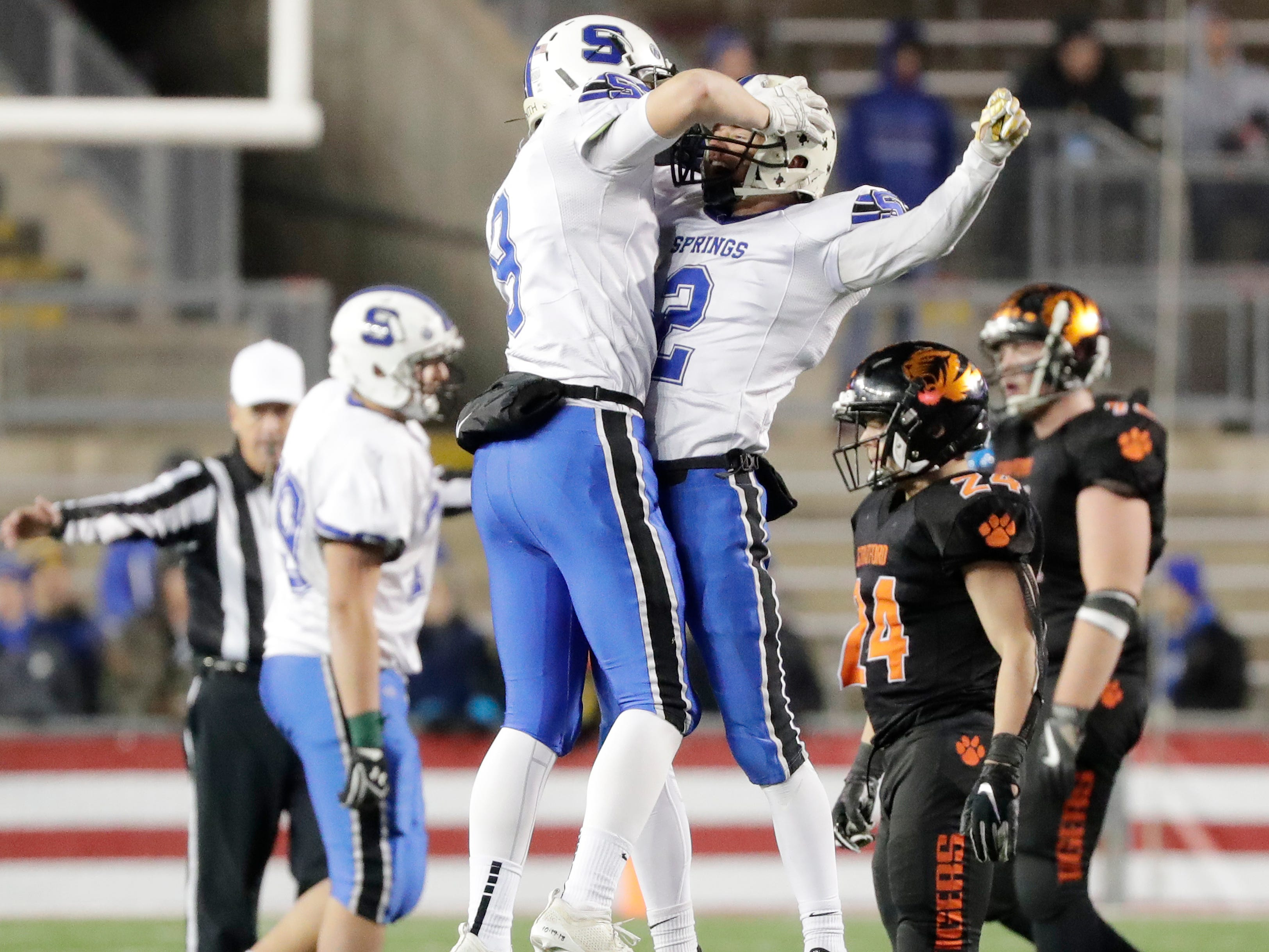 St Mary's Springs Academy's Matthew Moul (2) and Cade Christensen (9) celebrate near the end of the fourth quarter against Stratford in the WIAA Division 5 championship game at Camp Randall Stadium on Thursday, November 15, 2018 in Madison, Wis.