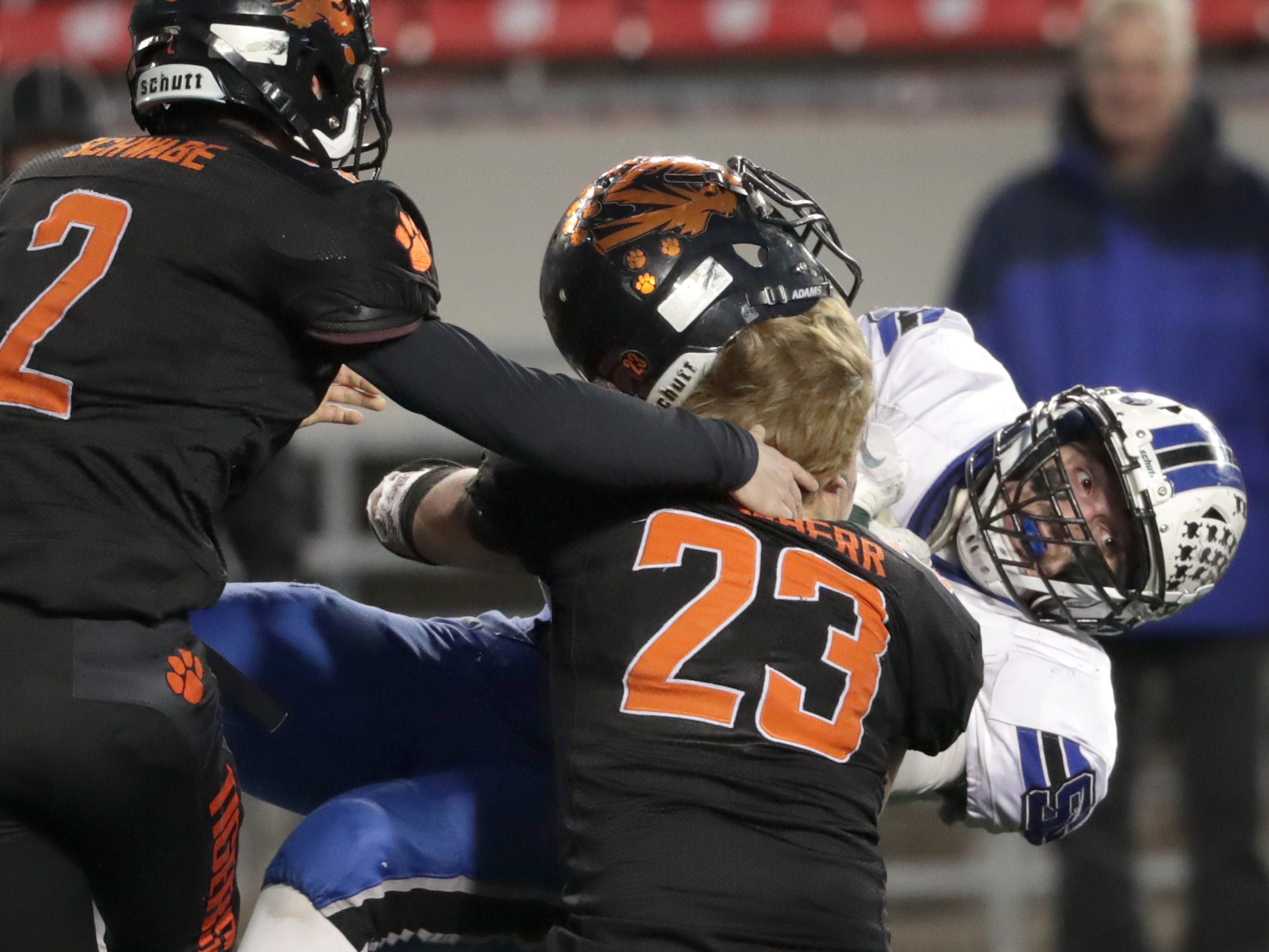Stratford High School's 323 Justin Schoenherr tackles St. Mary's Springs Academy's #35 Marcus Orlandoni during the WIAA Division  5 state championship football game on Thursday, November 15, 2018, at Camp Randall in Madison, Wis.