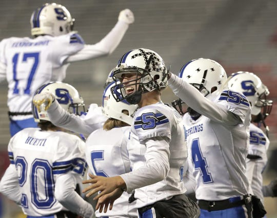St. Mary's Springs' Mitchell Waechter celebrates the Ledgers' victory over Stratford in the WIAA Division 5 state championship football game Thursday at Camp Randall in Madison.